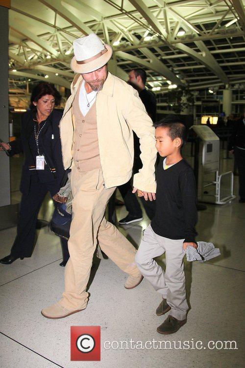 Brad Pitt and Maddox 5