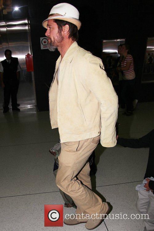 Brad Pitt and son arrive at JFK International...