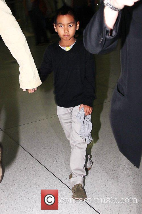 Maddox Jolie-Pitt arrives with his father at JFK...