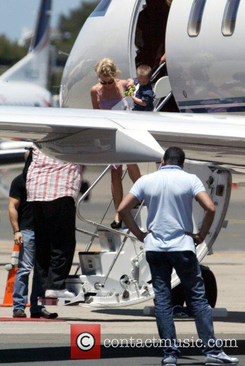 As she arrives into Sydney Airport aboard a...