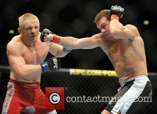 Dennis Siver left of Germany fighting Paul Kelly...