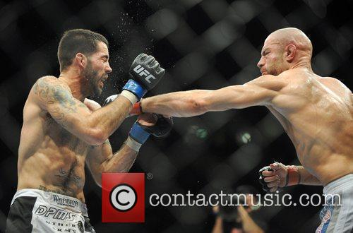 Winner Matt Brown of USA fighting James Wilks...