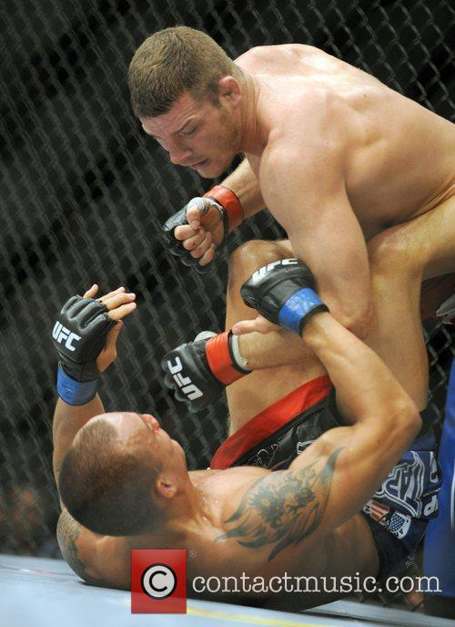winner Michael Bisping of Manchester, UK throwing punches...