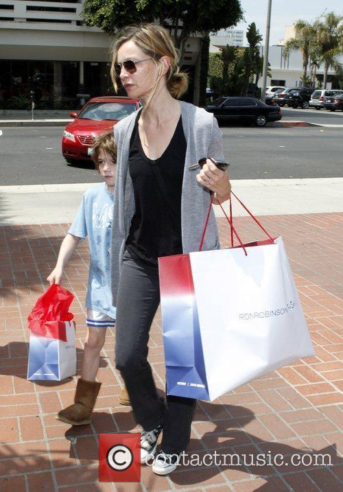 And her son Liam shopping at Fred Segal...