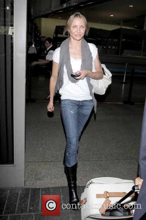 Cameron Diaz arriving at LAX airport while wearing...