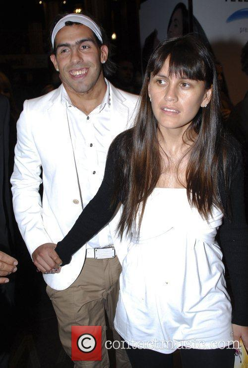 Carlos Tevez leaves the theatre with his wife