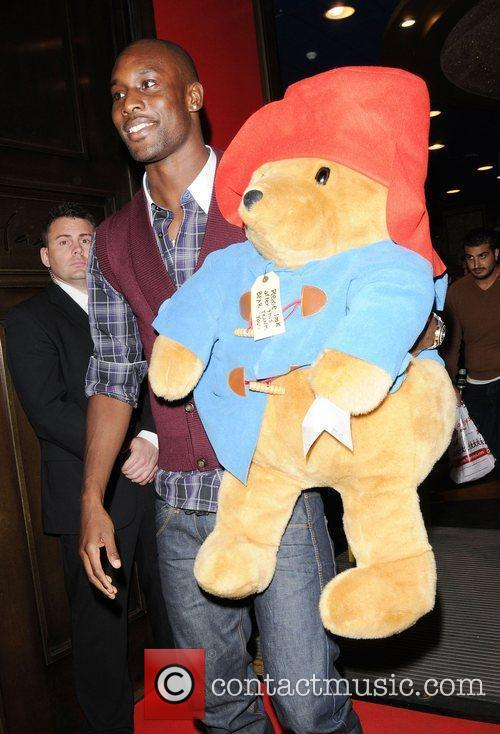 Carlton Cole holds a big Paddington Bear soft...