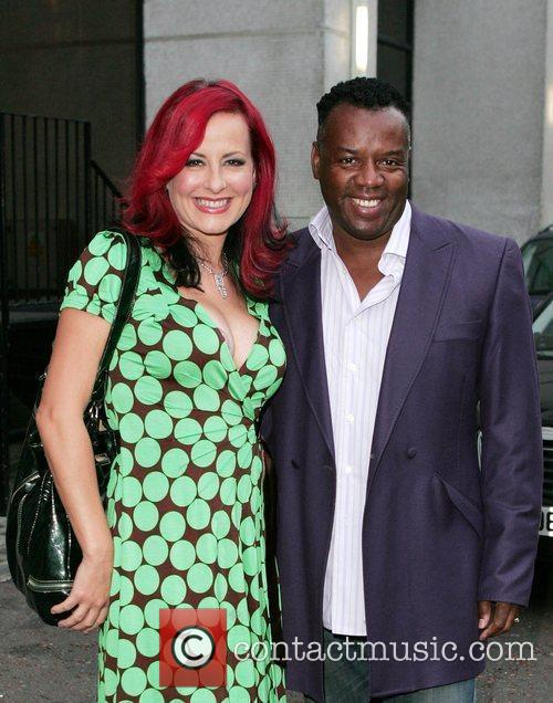 Carrie Grant and David Grant pose for pictures...