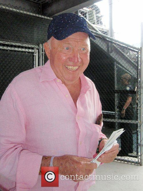 Bud Collins participate in the Chris Evert/Raymond James...