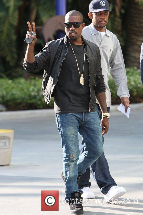 Kanye West,  arrives for the first game...