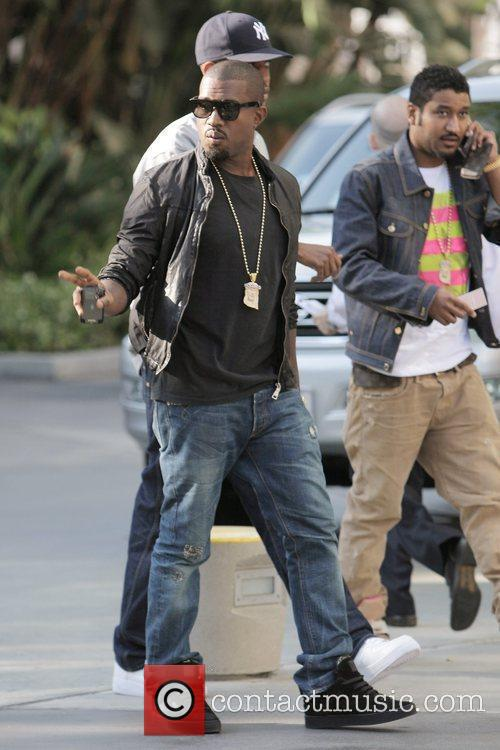 Kanye West arriving at the first game of...