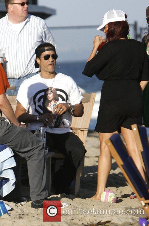 Slash enjoying a day at the beach