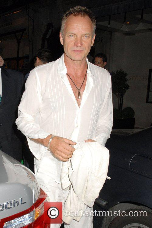 Sting gets into his car outside Scott's Restaurant....