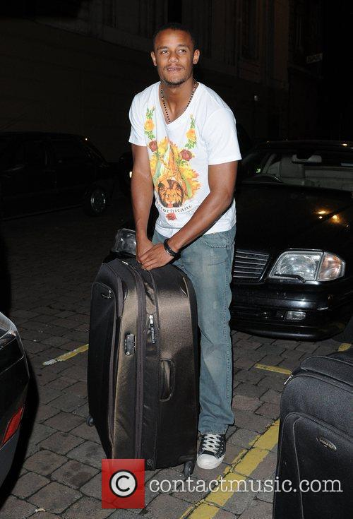 Carries his luggage to his car