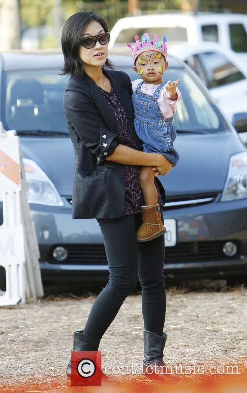 Christine Kim and daughter Luisa Danbi Grier-Kim visit...