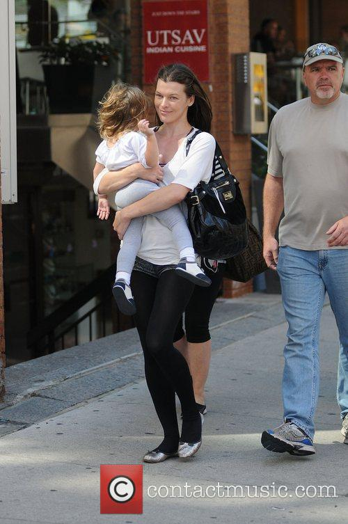 Milla Jovovich with her daughter Ever Gabo walking...