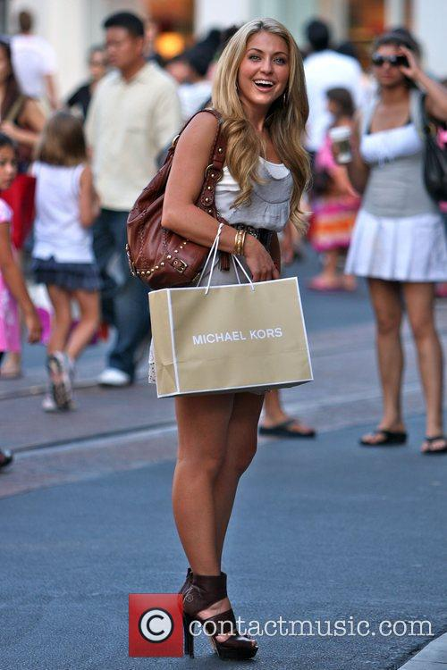Shops for clothes and shoes with friends in...