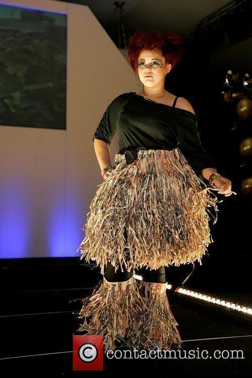 A model wears recycled clothes at a charity...