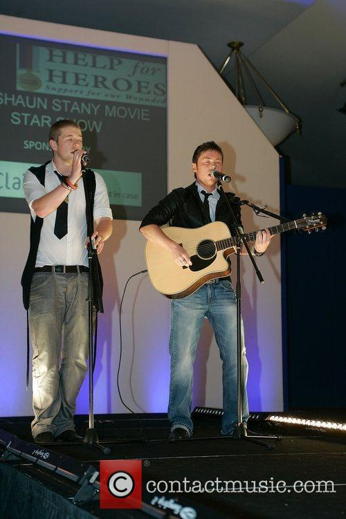 De-Tour performing live at a charity fashion event...