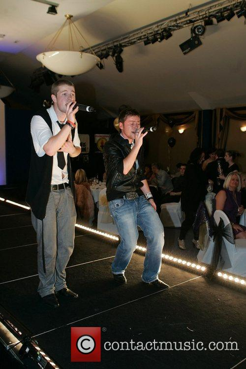Performing live at a charity fashion event held...