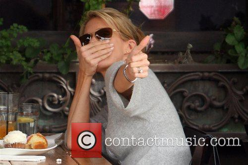 Cheryl Hines  gives the thumbs up after...