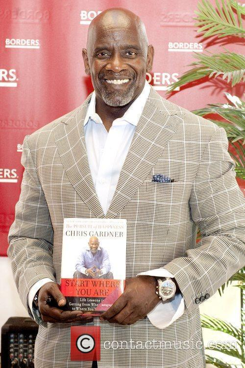Self-made millionaire and motivational speaker signs copies of...