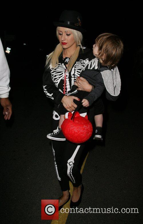 Singer Christina Aguilera and son Max arriving at...