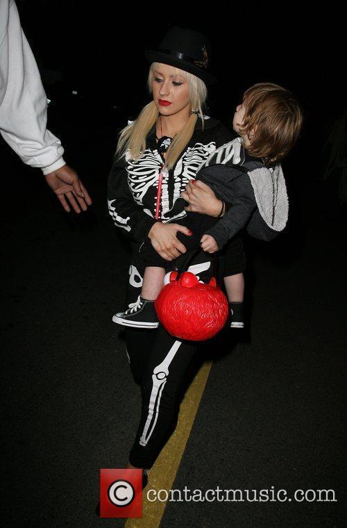 Singer Christina Aguilera and son Max arriving at...