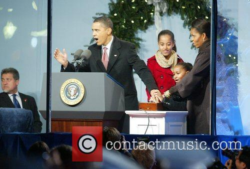 President Barack Obama, Malia Obama, Sasha Obama, and...