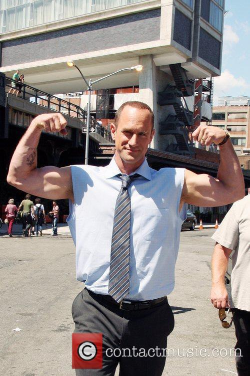 Christopher Meloni shows off his biceps during a...