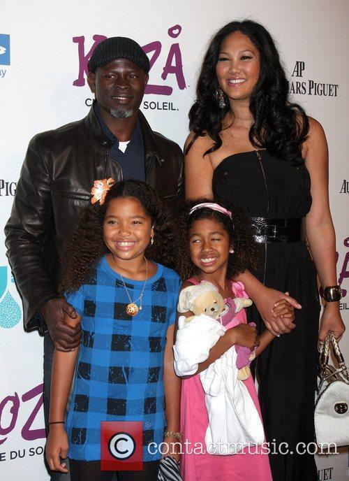 Kimora Lee Simmons and Djimon Hounsou with their...