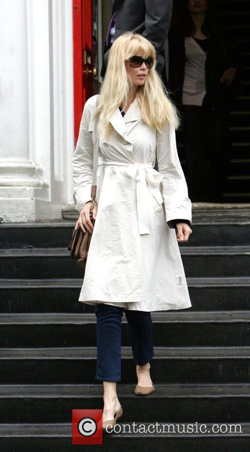Claudia Schiffer leaves her house to take her...