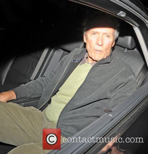 Film director Clint Eastwood leaving a London hotel...