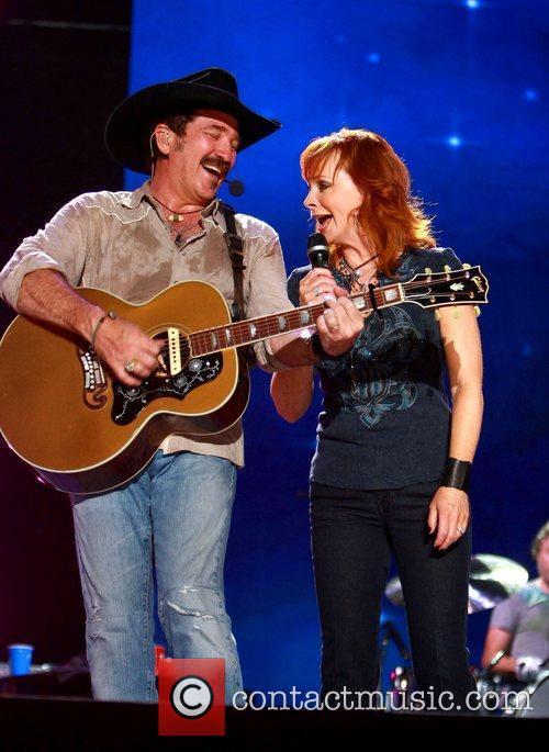 Kix Brooks and Reba McEntire performing live at...