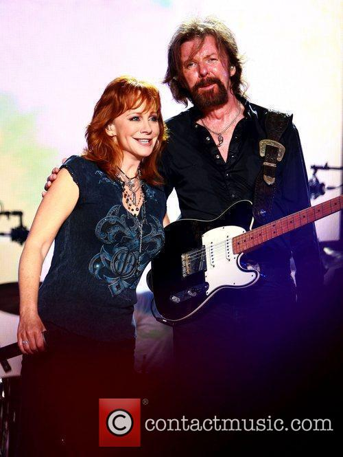 Reba McEntire and Ronnie Dunn performing live at...