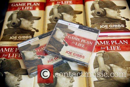 Signs copies of his new book 'Game Plan...