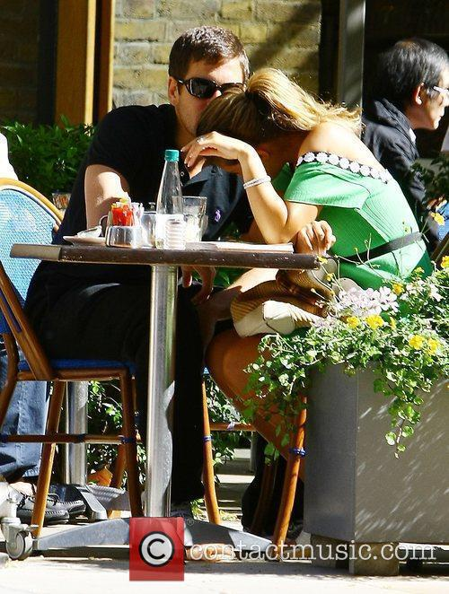 Carly Zucker  hides from photographers as she...