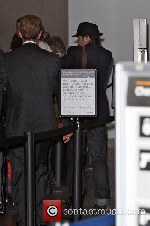 Colin Farrell goes through security at the Tom...