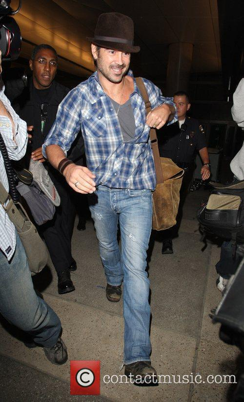 Colin Farrell arrives at LAX airport after flying...