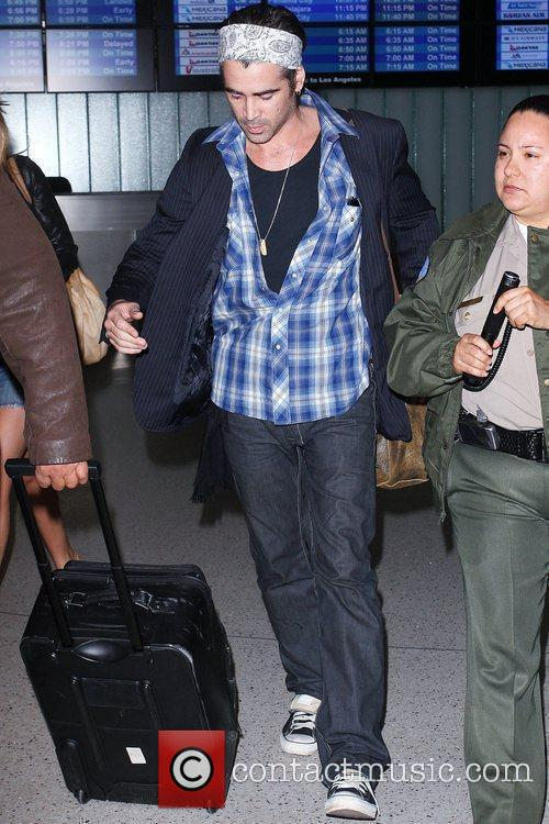 Colin Farrell arrives at LAX airport after vacationing...