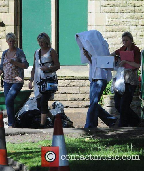 Katherine Kelly covering her head with a hood...