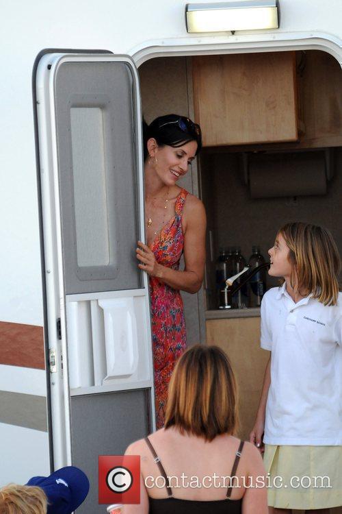 Courteney Cox talking to friends outside her trailer...