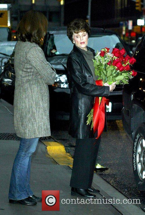 Carries flowers that were given to her daughter...