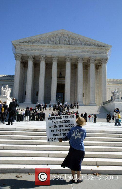 Religious activists protested outside the Supreme Court hearing...