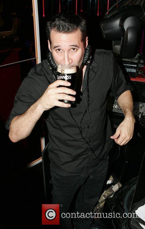 Dane Bowers drinks a pint of Guinness as...