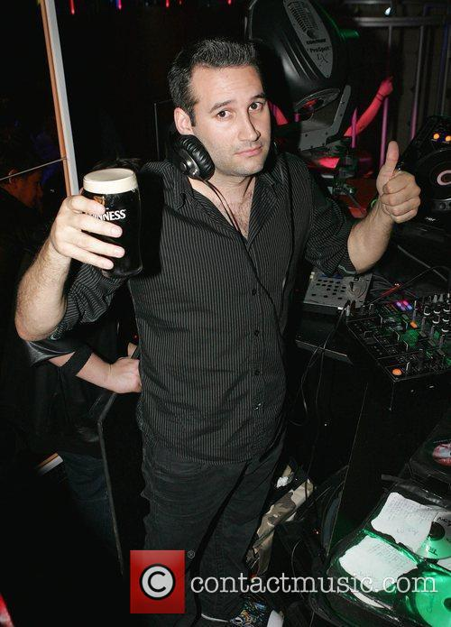 Dane Bowers with a pint of Guinness as...