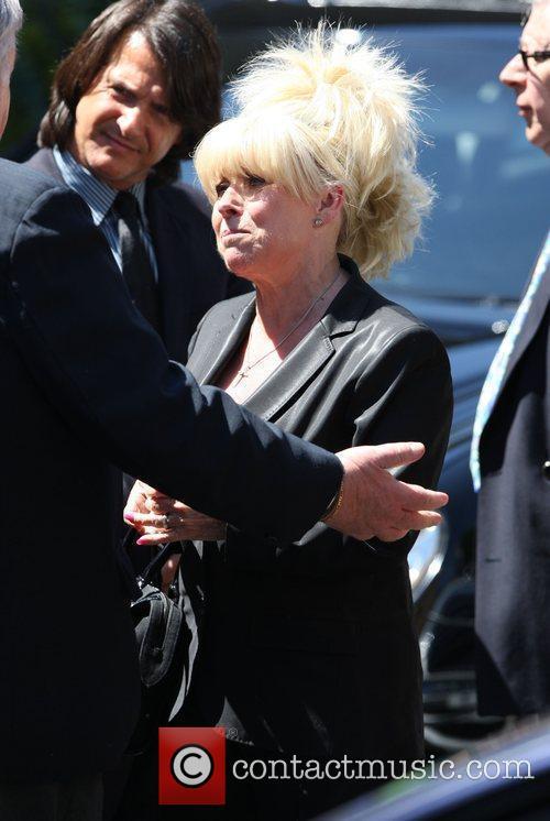 Barbara Windsor looks upset as she attends legendary...