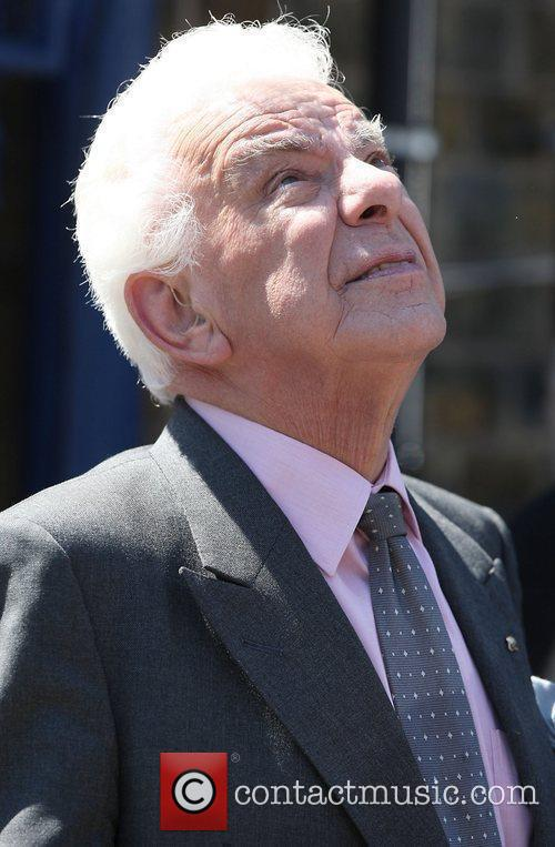 Barry Cryer looks upset as he attends legendary...