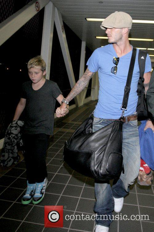 David Beckham arriving at LAX with his son...