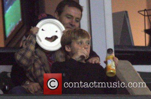 Romeo Beckham makes a funny face with a...